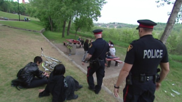 Saskatoon cops patrol a river side area in the city. Photo: CBC News.