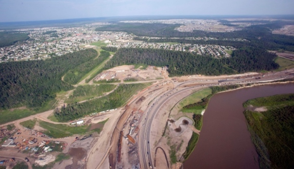 The Athabasca river, highway construction and suburbs seen from a helicopter in Fort McMurray, Alta., Tuesday, July 10, 2012. (Jeff McIntosh / THE CANADIAN PRESS)