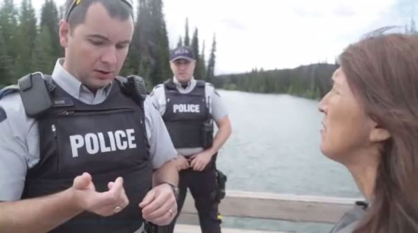 RCMP at the Unist'ot'en camp speak with Freda Huston, July 2015.