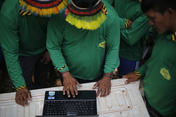 Ka'apor Indians setting up trap cameras in areas used by illegal loggers to invade the indigenous territory. Photograph: Lunae Parracho/Greenpeace