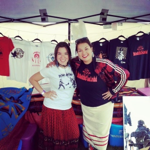 Eruoma Awashish (right) with Innu poet Natasha Kanape Fontaine, selling t-shirts on the powwow trail.