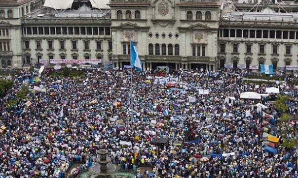 Protesters gather outside the National Palace in Guatemala City, June 2015. Photograph: Moisés Castillo/AP