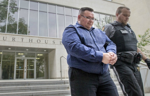 Former Whitecap Dakota First Nation accountant Hugo Gallegos was escorted from Saskatoon Court of Queen's Bench on Sept. 2, 2015, after being sentenced to five years in prison after pleading guilty to two counts each of theft over $5,000 and fraud over $5,000, a charge of laundering the proceeds of crime and a charge of possession of the proceeds of crime. (Gord Waldner / The StarPhoenix) Photograph by Gord Waldner, The StarPhoenix