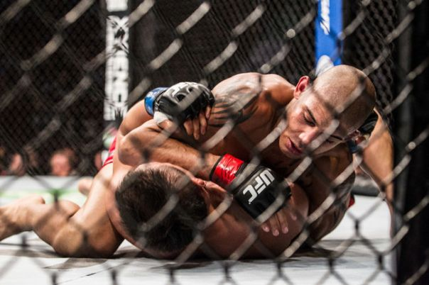 Burns Lake native Kajan Johnson (top) scored a big win Saturday at UFC Fight Night 75 in Japan. POSTMEDIA NETWORK