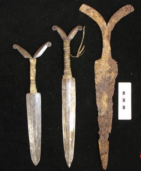 "Figure 13. Three Y-handled or athapaskan daggers. This image shows the contrast between an early wrought iron style from the Fraser River Basin (RBCM, ER-Y:1129) and two later ones ascribed as ""subarctic"" based on their style. (RBCM, Ethnology Collection 14982 and 14837). These later (1830s to early 1900s) varieties are narrower at the top of the blade and are less triangular in shape than earlier examples of this type."
