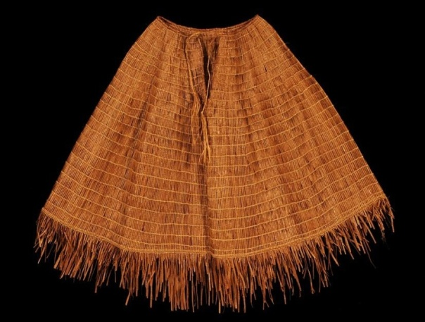 Cedar bark cape.  The head went through the hole, which was secured with ties, and the garment covered the shoulders and upper torso.