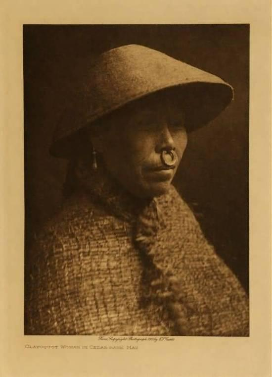 Nuu-Chah-Nulth woman with cedar bark hat and cloak. Photo: Edward S. Curtis.