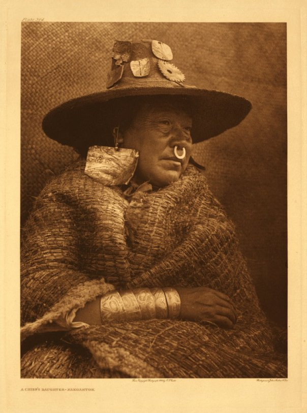 Kwakwaka'wakw woman with cedar bark hat and cloak. Photo: Edward S. Curtis.