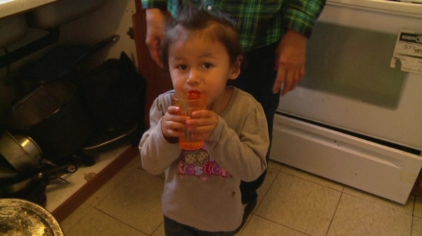 Three and a half year-old Hailey Sakanee takes a sip of water. Her community, Neskantaga First Nation, has been under a water advisory for two decades. (CBC)