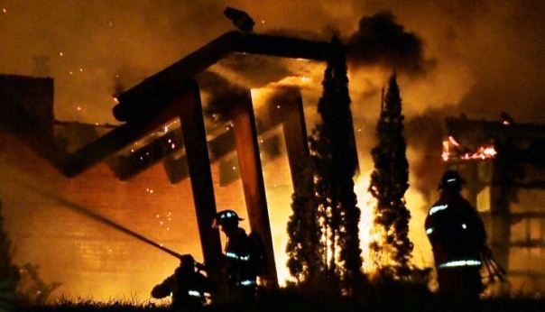 Fire fighters battle flames engulfing police station in Kanesatake, October 2015.