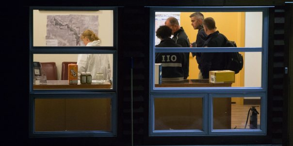 Investigators stand inside the Bridge River Indian Band office where one man died and nine others were injured following an attack, near Lillooet, B.C., on Wednesday October 14, 2015. A man suspected in a violent assault is dead and 10 others are hurt after an attack that reportedly involved a hammer. THE CANADIAN PRESS/Darryl Dyck