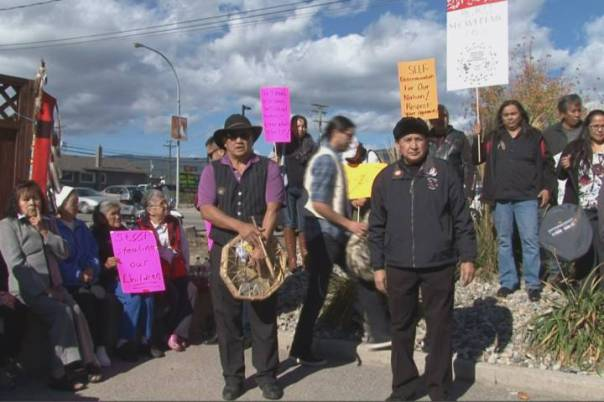 Splatsin Chief Wayne Christian and Chief Stewart Phillip of the B.C. Indian Chief's Union speak to a small crowd of protesters Tuesday outside B.C. Premier Christy Clark's office in West Kelowna. Contributed/ Global Okanagan