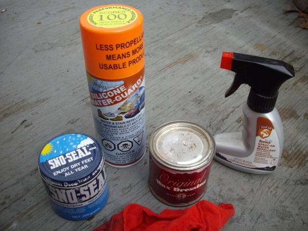 Various types of waterpoofing (L to R): SnoSeal, Atsko Silicone Water Guard, Original Wax Dressing by British Millerain Ltd, and McNett's Revivex. Each costs around $10.