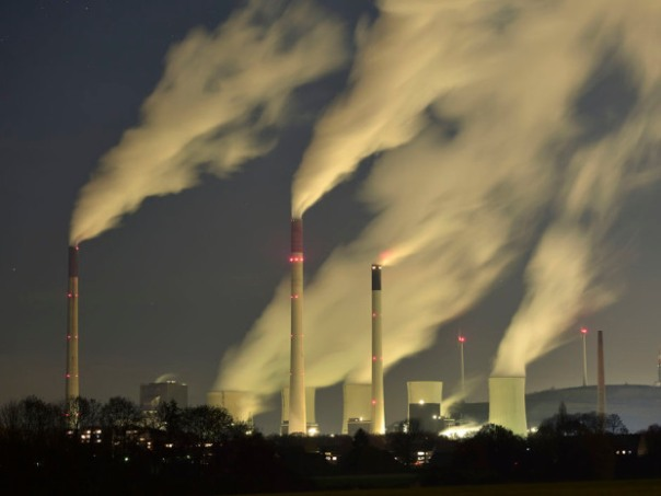 In this Nov. 24, 2014 file photo, smoke streams from the chimneys of the E.ON coal-fired power station in Gelsenkirchen, Germany. The U.N. weather agency says levels of carbon dioxide and methane, the two most important greenhouse gases, reached record highs last year.  Martin Meissner/ Associated Press