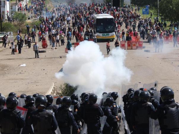 Oaxaca riot cops bus