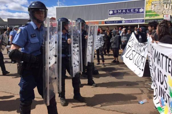 Elijah Doughty riot cops banners