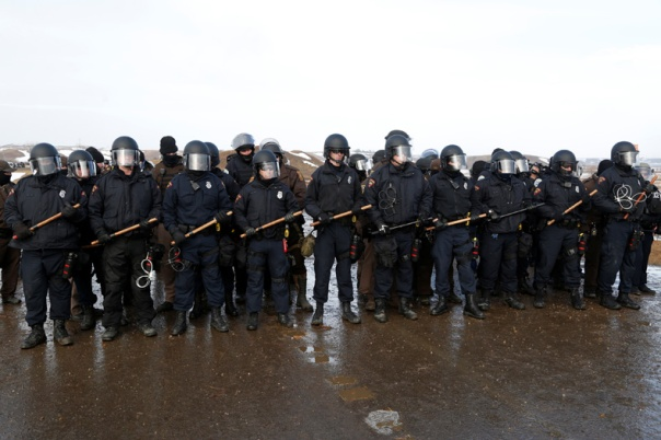 Police confront protesters refusing to evacuate the main opposition camp against the Dakota Access oil pipeline near Cannon Ball