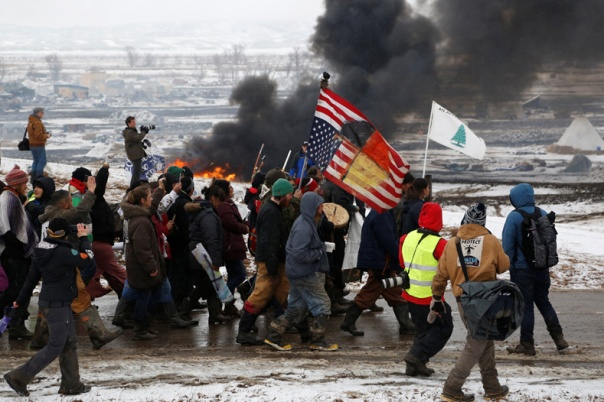 Protesters march on the outskirts of the main opposition camp against the Dakota Access oil pipeline near Cannon Ball