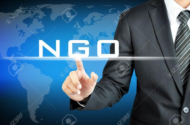 Businessman pointing on NGO (Non-Governmental Organization) sign