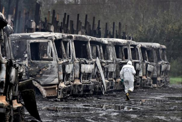 Burnt-out trucks are pictured in San Jose de La Mariquina commune, south of Santiago